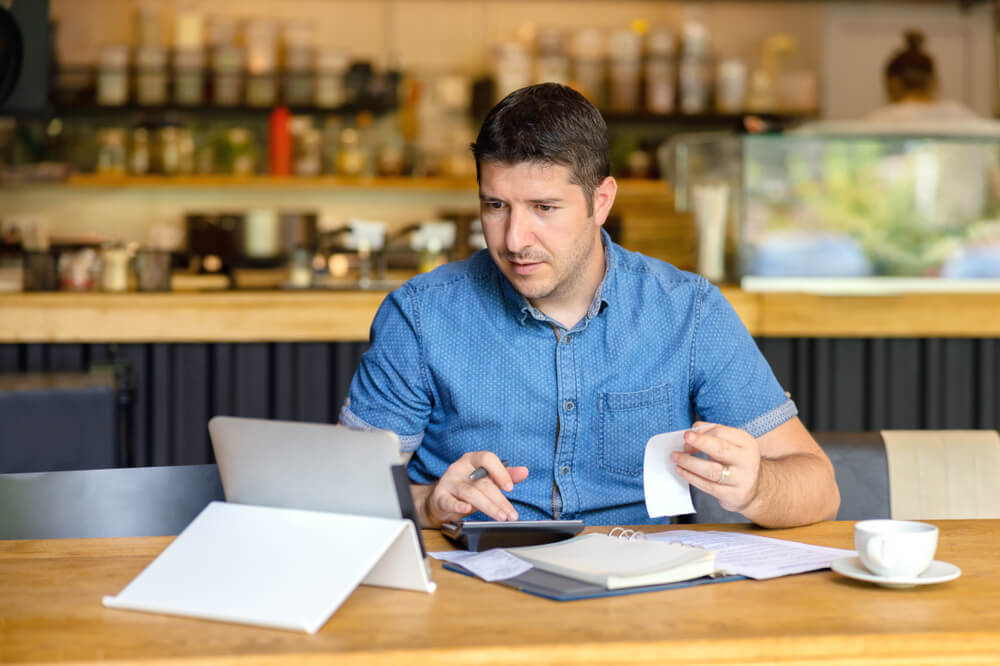 Restaurant Accounting - Restaurant Owner Performing Accounting, Counting Money