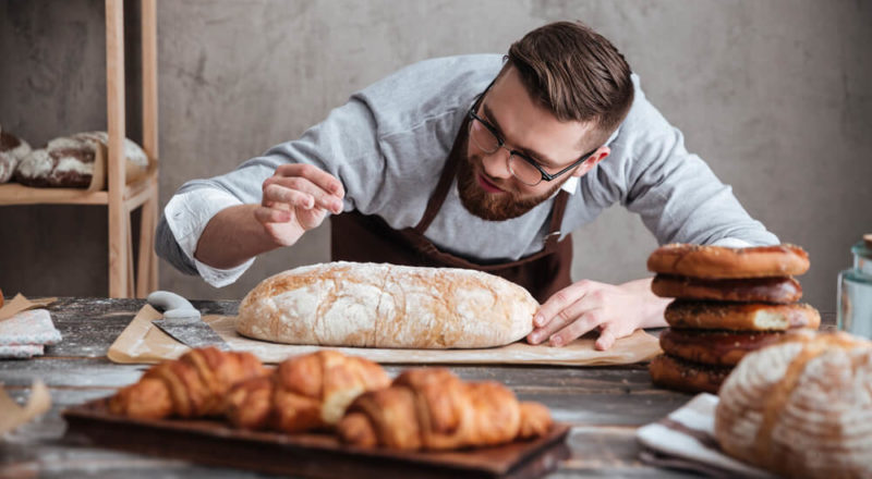 Restaurant Accounting young male baker baking money
